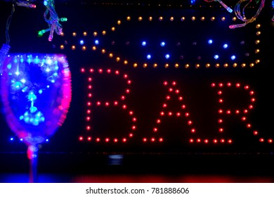 bar sign, one glass, Christmas lights