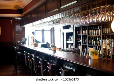 Bar with stools and drinks