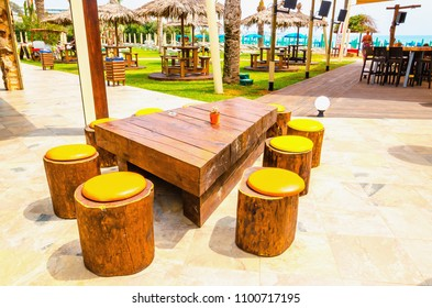 Bar with wooden round chairs on the beach, Paphos, Cyprus