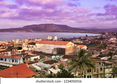 Baracoa, Cuba - aerial view of the town and the sea in sunset light