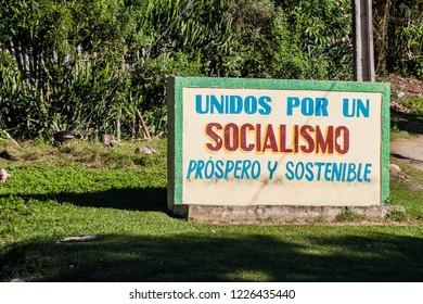 BARACOA, CUBA - FEB 5, 2016: Propaganda billboard in Baracoa. It says: United for the prosperous and sustainable socialism.
