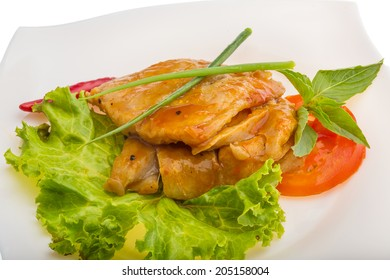 Baracuda steak with sauce and salad