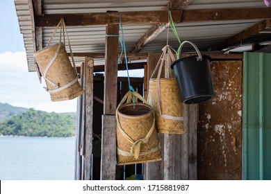 """""""Barait"""", the traditional Bag for the KadazanDusun and Murut people, made of bamboo and rattan using the 'anyaman' technique, hanging outside of a fisherman hut at Ambong Bay, Sabah Malaysia."""