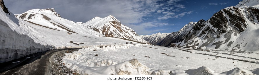 Bara-lacha Pass, Himachal / India - June 23 2014: A desolate desert of the Himalayas. Mountain pass along the Manali-Leh highway with stunning sand and rock formations, snow-peaks and glaciers