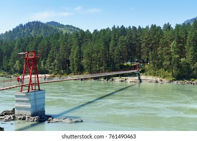 Barangol, Russia - July 27, 2017: Suspension bridge over river Katun in village Barangol. Altai Republic, Siberia.