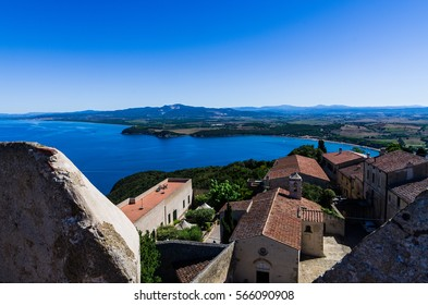Baratti Gulf taken from Populonia Castle and its ancient houses, in a sunny summer day