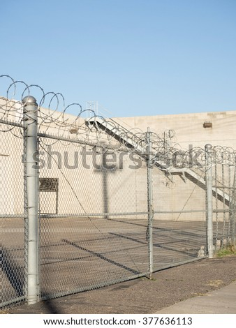 Barb Wire Fence Building   Barb Wire Prison Fence Prison Building Stock Photo Edit Now