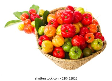 Barbados cherry with bamboo basket, on white isolate background.