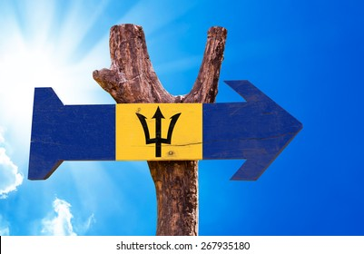 Barbados Flag wooden sign with sky background