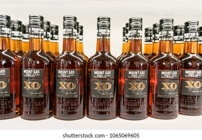 Barbados, March 23, 2018: Bottles of Mount Gay XO rum stand on a shelf at Mount Gay distillery.
