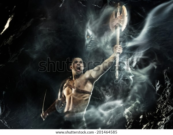 Barbarian. Strong man evokes the spirit of weapon
