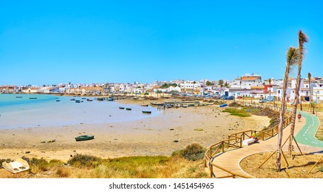 Barbate, Spain - June 25, 2019. The mouth of the Barbate river with the Barbate Town in the background. View from Juan XXIII Avenue. Barbate, Andalusia, Spain.