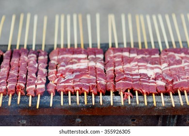 Barbecue with Arrosticini, a typical italian small skewers, at Campo Imperatore
