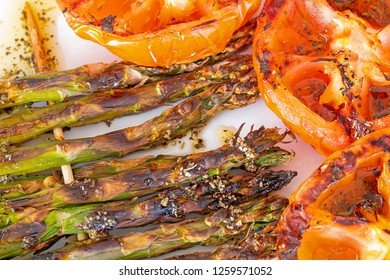 Barbecue asparagus and tomatoes skewers.