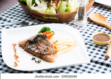 Barbecue beef steak with Cesar Salad