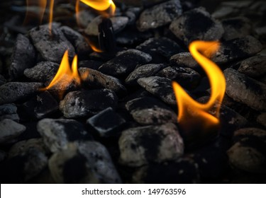 Barbecue brazier with small flames.