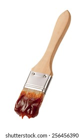 Barbecue Brush with a Wooden Handle isolated on white. The image is in full focus, front to back.