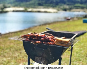 barbecue camping food, blurry natural view at campsite in morning background no people, easy simple breakfast, toast, bread, potato, bacon and eggs on charcoal grill, backpackers menu creative idea