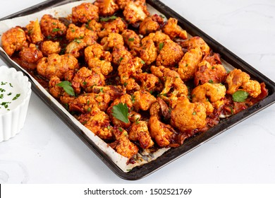 Barbecue Cauliflower Wings on a Baking Sheet.  Healthy Baked Cauliflower Appetizer Photo.