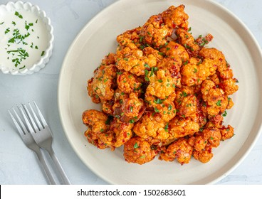 Barbecue Cauliflower Wings on a White Plate. Buffalo  Cauliflower Bites Photo.