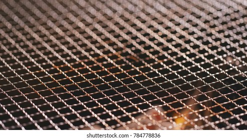 Barbecue Charcoal on fire with metal net