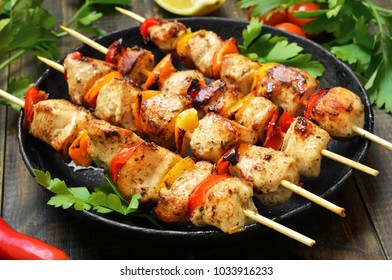 Barbecue, chicken kebab with vegetables, close up view.
