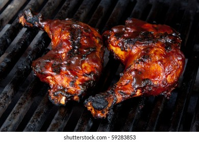 Barbecue Chicken Leg Quarters on Grill with Sauce