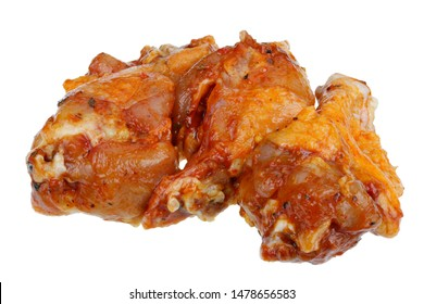 Barbecue chicken legs marinated in lingonberry chilli sauce and Italian herbs. Isolated on white studio macro