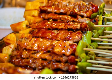 Barbecue Chicken Skewers in red sauce, Thai Street Food Background Thailand