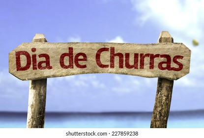 Barbecue Day (In Portuguese) wooden sign with a beach on background