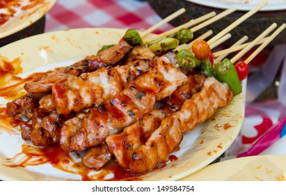 Barbecue with delicious grilled meat on dish