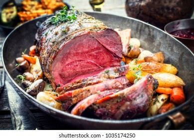 Barbecue dry aged haunch of venison with mushroom and vegetable as close-up in a vintage casserole