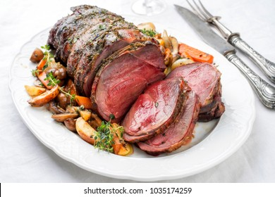 Barbecue dry aged haunch of venison with mushroom and vegetable as top view on a plate