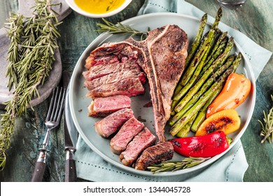 Barbecue dry aged Steak sliced with green Asparagus T-bone steak