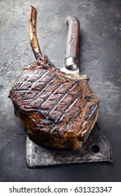 Barbecue dry aged Wagyu Tomahawk Steak as close-up on old metal sheet