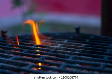 Barbecue empty grill with shimmering coal and bright flames