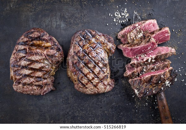 Barbecue Entrecote Steaks on old Metall Sheet