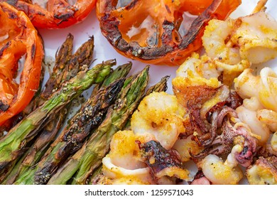 Barbecue fish skewer and some vegetables.