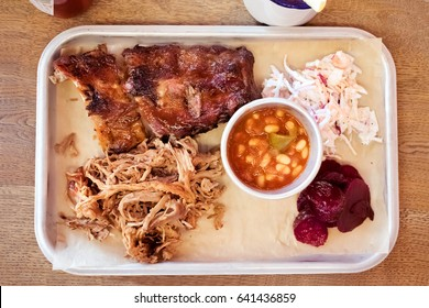 Barbecue food, ribs, pulled pork, beans, coleslaw. BBQ