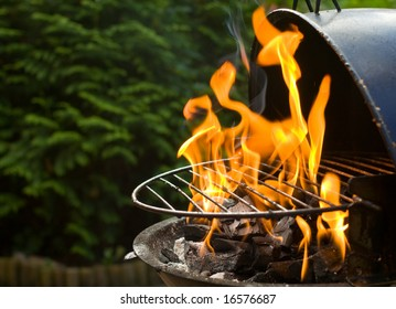 Barbecue grill heating up with flames