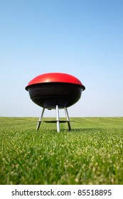Barbecue grill on green meadow