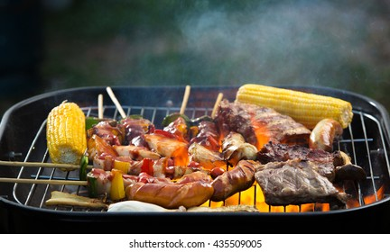 Barbecue grill on a barbecue on the grill with meat and vegetables.