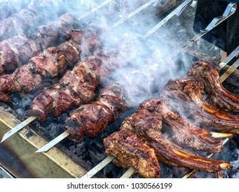 Barbecue grill with various kinds of meat, closeup