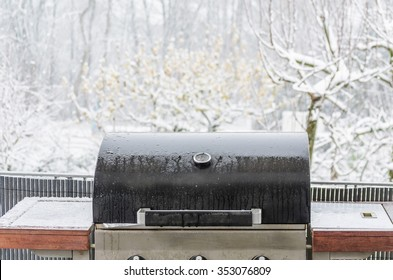 Barbecue grill in the winter on a balcony ready for winter grilling.