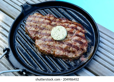 barbecue grilled steak with garlic butter at the  swimming pool party