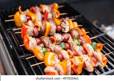 Barbecue Kabobs Smoking On The Grill. Smoked Meat And Vegetables. Grilling Kebabs On The Barbeque. Selective Focus With Copy Space.