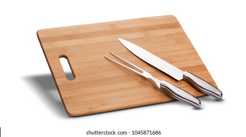 Barbecue kit with wood to cut meat, knife and long fork, isolated in white background.