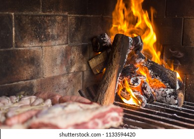 Barbecue. Meat cuts warming on the embers on an iron grill. Traditional Argentinian bbq.