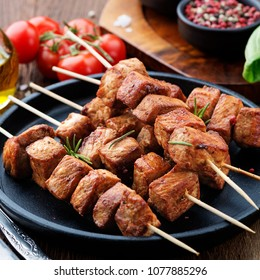 Barbecue meat. Grilled pork skewers on wooden table.