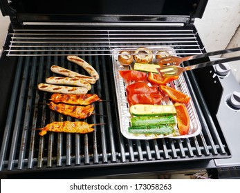 barbecue on a grill at a nice evening